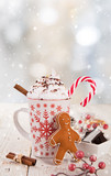 Christmas cup with hot chocolate and whipped cream. - 231704218