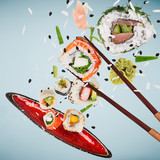 Pieces of delicious japanese sushi frozen in the air. - 231704468