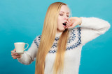 Sleepy woman holding cup of coffee - 231705032