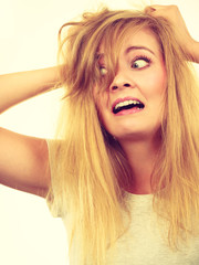 Crazy, mad blonde woman with messy hair © Voyagerix
