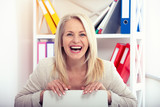 Happy modern businesswoman. Beautiful middle aged woman looking at camera. - 231705610