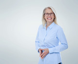 Business woman in glasses and blue shirt isolated on grey. Happy pretty women - 231706082