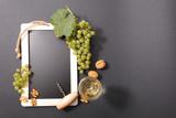 blackboard with grape and white wine