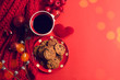 vintage red color cookies dessert sweet and coffee with bokeh light and decoration for season greeting of merry christmas concept