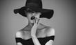 Flirty elegant female in black and white
