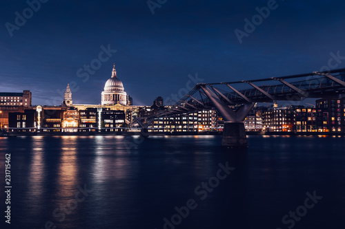 Modern London city skyline St Pauls Cathedral and Bridge River Thames at night