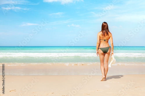 Young attractive woman on the beach