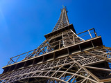 Eiffel Tower replica made of steel against a blue sky without clouds.