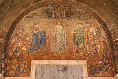 LONDON, GREAT BRITAIN - SEPTEMBER 17, 2017: The mosaic of Jesus Christ in Westminster cathedral with the symbolic wine and bread designed by Clayton & Bell (begin of 20. cent.). © Renáta Sedmáková