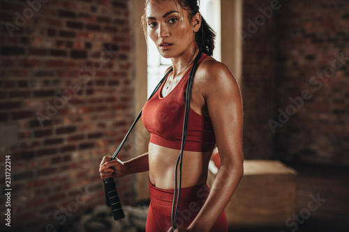 Wall mural Sportswoman resting after workout