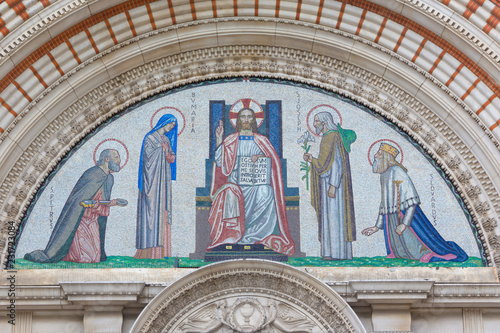 LONDON, GREAT BRITAIN - SEPTEMBER 19, 2017: The mosaic of Jesus Christ the Pantokrator over the main portal of Westminster cathedral designed by by RobertAnning Bell (1863 – 1933). © Renáta Sedmáková