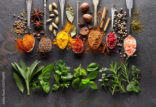 Spices and herbs on black board © Dionisvera