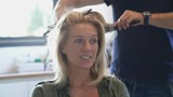 Woman getting her hair curled  - 231749499