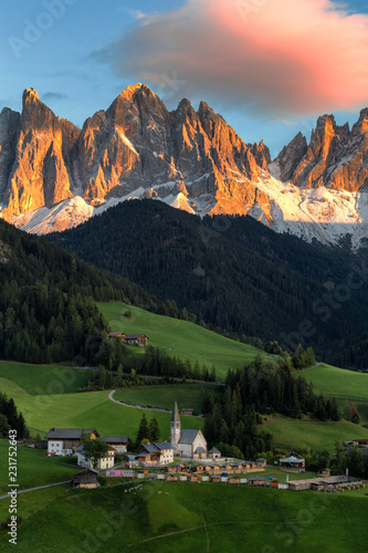 Beautiful idyllic mountain scenery in the Dolomites in golden evening light at sunset in fall colours, Val di Funes, South Tyrol, northern Italy