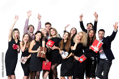 Foto Murales Friends in stylish clothes with gift boxes in hands having fun.