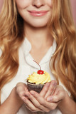 Woman hands holding a delicious yummy cupcake - 231759660