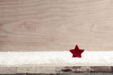 Christmas background with red star and white snow.