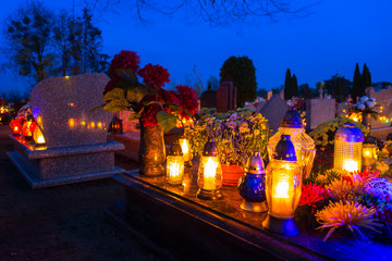 Colorful candles on the cemetery at All Saints Day, Poland