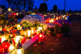 Colorful candles on the cemetery at All Saints Day, Poland - 231764627