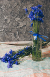 Seasonal summer flowers blue cornflowers and fruits strawberries on a napkin close-up conceptual background