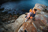 Love couple on end of the rock with sea view