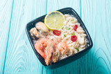 Instant noodles soup with shrimps and mssels . Asian food