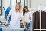 Women ironing in dry cleaning shop - 231783095