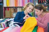 young women customers buying fabric