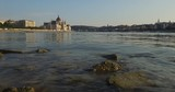 View of the calm Danube River with its panorama as world heritage site of Budapest, from the riverside. - 231792428
