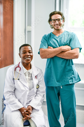 Leinwanddruck Bild Happy doctor and nurse at a hospital