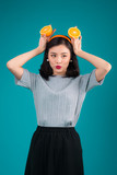 Healthy food. Smiling lovely pinup asian girl holding orange over blue background. - 231829047