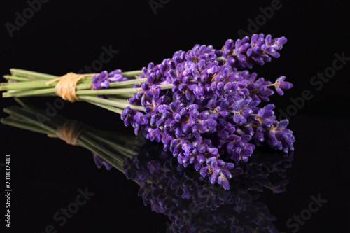 Bouguet of violet lavendula flowers isolated on black background, close up - 231832483