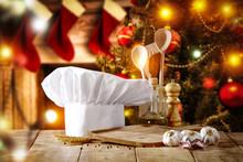 """Постер, картина, фотообои """"Cook hat on table and christmas tree with fireplace """""""
