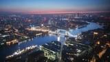 time lapse London skyline with illuminated Tower bridge and Canary Wharf in sunrise time, UK - 231839633