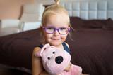 Portrait of beautiful little girl in glasses - 231840055
