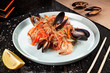 Delicious close up view on Chinese noodles with mussels. Chinese cuisine, dark backround, top view food, copy space for text, selective focus. Asian fastfood. - 231840893