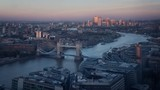 time lapse London skyline with illuminated Tower bridge and Canary Wharf in sunset time, UK - 231842205