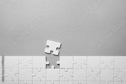 Leinwandbild Motiv Jigsaw puzzle on light background