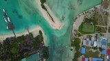Flight over the tropical island of Huraa located in the Indian Ocean. Maldives - 231846296