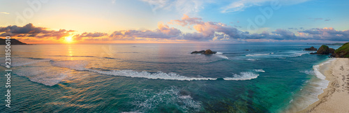 Panoramic view of tropical beach with surfers at sunset. - 231850610