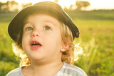 Funny pictures of a little girl. Portrait of a little girl with a cap - 231851426