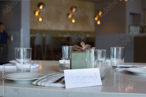 Restaurant Table Setting And Reserved Sign. Luxury Premium Dining Restaurant.  Serving On The Table