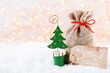 Christmas greeting card. Christmas tree branch on glitter golden bokeh lights background. New Year concept. Copy space. - 231861016