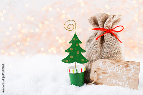 Christmas greeting card. Christmas tree branch on glitter golden bokeh lights background. New Year concept. Copy space. © gitusik