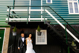wedding couple posing under the steps of green house - 231861628