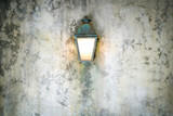 Rough cement wall texture background with a lamp - 231866455