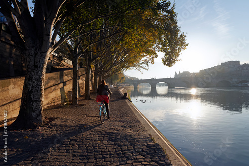 Sunrise and cyclist on the seine river quay in Paris