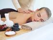 Leinwanddruck Bild - Woman having massage in the spa salon
