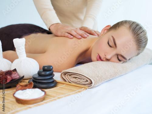 Leinwanddruck Bild Woman having massage in the spa salon