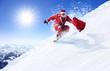 Leinwandbild Motiv Weihnachtsmann auf dem Snowboard